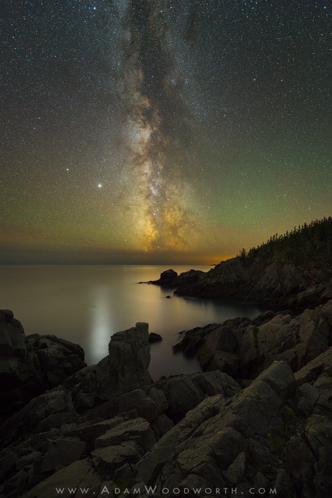 "Another beautiful night on the coast of Maine, with the glow of the Milky Way and Jupiter reflecting in the ocean. Saturn is also visible, to the upper-left of Jupiter.  Nikon Z 7, Mount Adapter FTZ, NIKKOR 14-24mm f/2.8 lens @ 14mm, f/2.8.  Sky: Star stack of 20 exposures at ISO 6400 and 10 seconds. Stacked in the new version of Starry Landscape Stacker that supports raw files, making the workflow a bit easier.  Foreground: Two exposures each at ISO 1600 and 10 minutes, focus stacked. The foreground raw files were processed in Capture One Pro because Lightroom does not let you disable built-in lens profiles, which most mirrorless cameras have when using OEM lenses. This causes very bad warping artifacts, so the workaround I am now using is to use another raw editor to prep photos when I need to disable built-in lens profiles. Capture One allows you to do this, plus its automatic hot pixel removal is the best I've seen in a raw editor, and it even has a ""Single Pixel"" slider allowing you to remove most of the more stubborn hot pixels. Careful using it on star images, it can eat away at stars, but so far I only use it on my long exposure foregrounds where the sky is blurred and will be replaced anyways. Since I rely on Capture One now for hot pixel removal in foreground shots I don't bother with Long Exposure Noise Reduction, which cuts the capture time in half.  The foreground images and star stacked sky result image were blended in Photoshop to create the final image, with edits applied to bring out colors and details as usual. All shots in the same place on the same night without moving the camera."